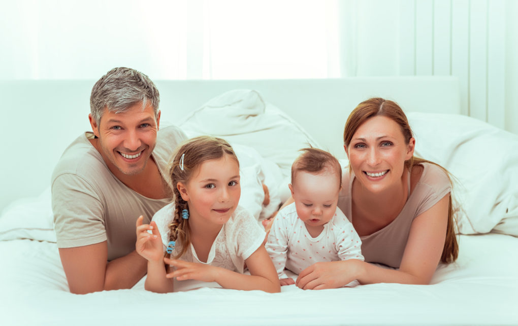 Happy family at home with life insurance