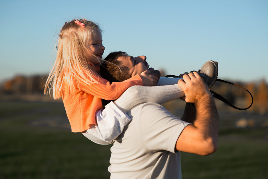 Man with daughter. They have disability insurance